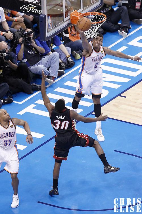 14 June 2012: Oklahoma City Thunder shooting guard Thabo Sefolosha (2) blocks Miami Heat point guard Norris Cole (30) layup during the Miami Heat 100-96 victory over the Oklahoma City Thunder, in Game 2 of the 2012 NBA Finals, at the Chesapeake Energy Arena, Oklahoma City, Oklahoma, USA.