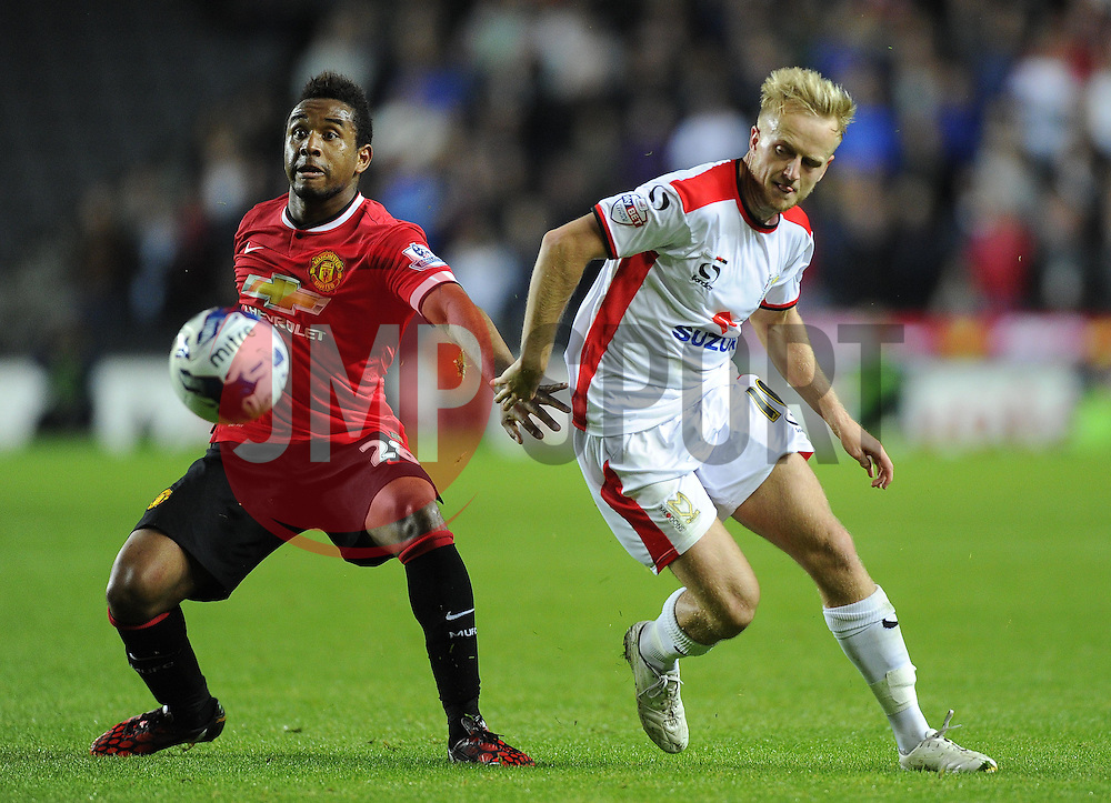 Milton Keynes Dons' Ben Reeves beats Manchester United's Anderson to the ball - Photo mandatory by-line: Joe Meredith/JMP - Mobile: 07966 386802 26/08/2014 - SPORT - FOOTBALL - Milton Keynes - Stadium MK - Milton Keynes Dons v Manchester United - Capital One Cup