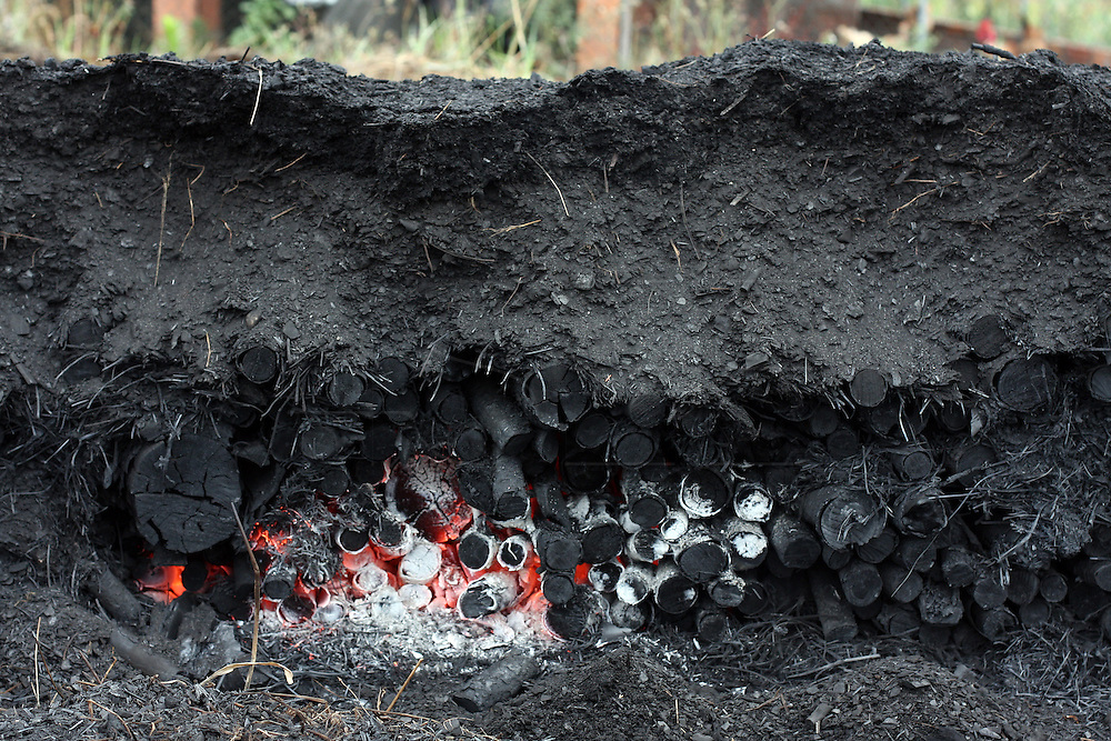 A pile of sharcoal burning in the stove . In the village of Pilado in the county of Marinha Grande, sharcoal production goes back to the sixth century, always executed by women, today due to unemployment, men are taking the responsability for this handicraft industry. Sharcoal is used as an alternative  power, most of all to grill.Paulo Cunha/4see