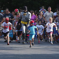 Runners begin the Super Hero Fun Run Saturday July 26, 2014 at the Myrtle Grove Library in Wilmington, N.C. (Jason A. Frizzelle)