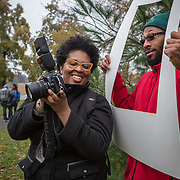 WASHINGTON, DC - NOV 16 :  Kimberly Gaines, a community organizer, photographs RonDell Pooler who works for Washington Parks and People, at the Marvin Gaye Park, November 16, 2013, in Deanwood, Washington, DC. Gaines and fellow community organizer Sheshat Walker, are working on a project called My Deanwood, where they photograph community members and write stories about them. (Photo by Evelyn Hockstein/For The Washington Post)