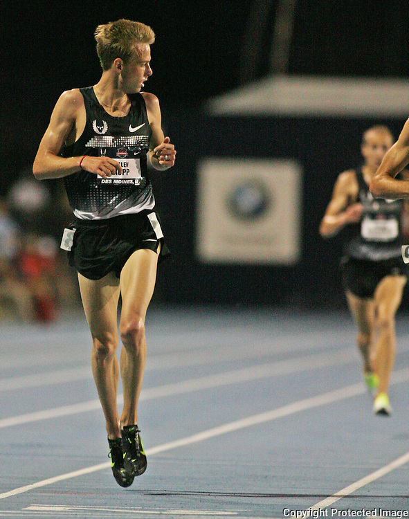 RUPP - 13USA, Des Moines, Ia.  - Galen Rupp checked behind him at the finish of the 10,000 but no one was close. Photo by David Peterson
