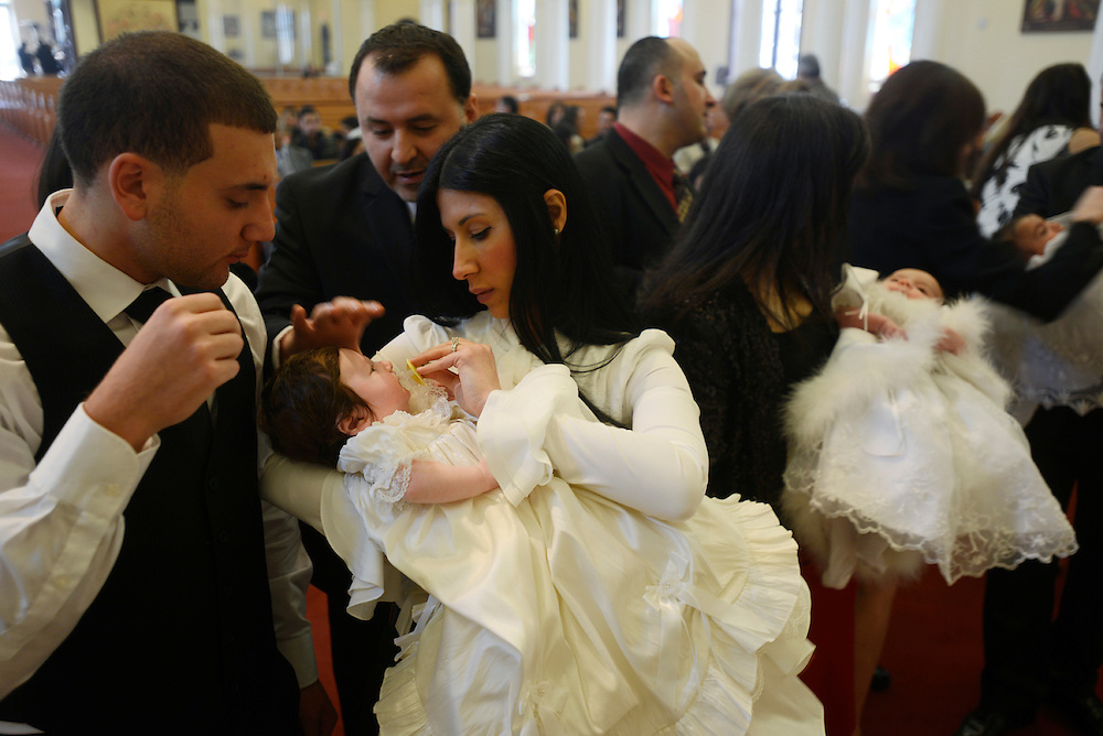 Iraqi families baptize their children during a ceremony at the Saint George Chaldean church. A new generation of Iraqis is being born into the ever-expanding Iraqi community in the United States. Shelby Township, MI, USA. 14/04/2013.