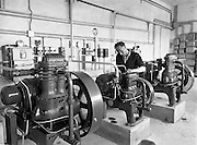 14-15/ 05/ 1959<br /> 05/14-15/1959<br /> 14-15 May 1959<br /> Engineer Colm O Labhrada tends to the engines at the Gael Linn fish and vegetable processing plant, Carna, Co. Galway.