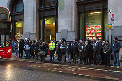 © Licensed to London News Pictures. 05/02/2014. London, UK. Early morning bus queues form at Bank in the City of London this morning, 5th February 2014. London Underground union members from the RMT and TSSA unions have gone on a 48 hour strike, which started at 9pm on 4th February 2014, over proposals by Transport for London (TfL) to cut jobs and close ticket offices. Photo credit : Vickie Flores/LNP
