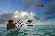 Kite Surfer rides in the late afternoon in Aruba. December 2005