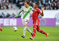 v.l. Bas Dost (Wolfsburg), Jerome Boateng<br /> Fussball Bundesliga, VfL Wolfsburg - FC Bayern München<br /> Norway only<br /> <br /> Håvard Nielsen