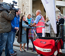 © Licensed to London News Pictures. 16/04/2012. London, U.K..Royal Mail Postman Mike Chandler meets the Mayor on his arrival at the Haven breast cancer support centre in Fulham, London, after his pre-marathon 150 mile run from the Haven centre in his home town of Hereford to raise £20,000 for the charity. He will also run the London Marathon next Sunday 22nd April..Photo credit : Rich Bowen/LNP