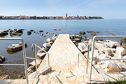 THEMENBILD - Porec ist eine Stadt an der Westkueste von der kroatischen Halbinsel Istrien, im Bild die Skyline von Porec mit einem Einstieg ins Meer . Aufgenommen am 12. April 2017 // Porec is a town on the western coast of the Croatian peninsula Istria, This picture shows the skyline of Porec, Porec, Croatia on 2017/04/12. EXPA Pictures © 2017, PhotoCredit: EXPA/ Sebastian Pucher
