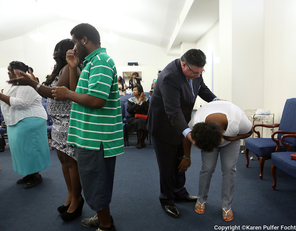 Alonso Esposito, a former Boston mobster-turned pastor, prays with a member of the congregation who was overcome with emotion during the service at Faith Keepers Ministry in Memphis on Sunday, June 26th, 2016.
