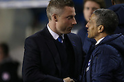 Neil Harris and Chris Hughton during the Sky Bet Championship match between Millwall and Brighton and Hove Albion at The Den, London, England on 17 March 2015.