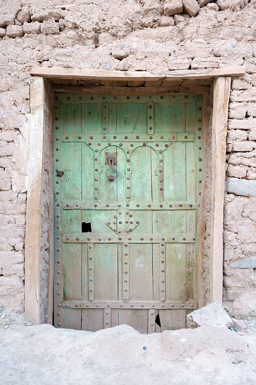 Traditional Southern Moroccan Kasbah Step Down Door, Agdz, Morocco, Agdz, Draa Valley, Southern Morocco, 2015-06-13. <br />