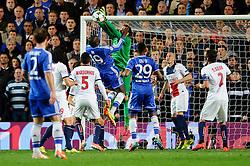 PSG Goalkeeper Salvatore Sirigu (ITA) blocks a header from Chelsea Forward Demba Ba (SEN) - Photo mandatory by-line: Rogan Thomson/JMP - 07966 386802 - 08/04/2014 - SPORT - FOOTBALL - Stamford Bridge, London - Chelsea v Paris Saint-Germain - UEFA Champions League Quarter-Final Second Leg.