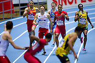 (L) Kacper Kozlowski of Poland and (C) Clayton Parros of USA compete in men's relay 4x400 meters qualification during the IAAF Athletics World Indoor Championships 2014 at Ergo Arena Hall in Sopot, Poland.<br /> <br /> Poland, Sopot, March 8, 2014.<br /> <br /> Picture also available in RAW (NEF) or TIFF format on special request.<br /> <br /> For editorial use only. Any commercial or promotional use requires permission.<br /> <br /> Mandatory credit:<br /> Photo by © Adam Nurkiewicz / Mediasport