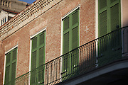 Green shutters on a brick building in New Orleans, Louisiana.