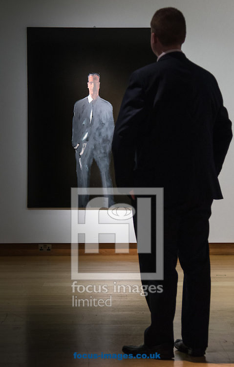 A man admires Michelangelo Pistoletto's &quot;Il Presente. Figura su sfondo nero V (The Present. Figure on a Black Ground V)&quot;, which is expected to fetch up to &pound;550,000 at auction, during the 20th Century Art Sale Preview at Christie's, London<br /> Picture by Paul Davey/Focus Images Ltd +447966 016296<br /> 05/02/2016