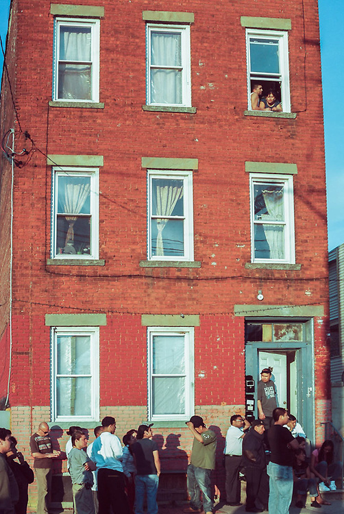 People on street in front of apartment building in Paterson, NJ Circa 2005
