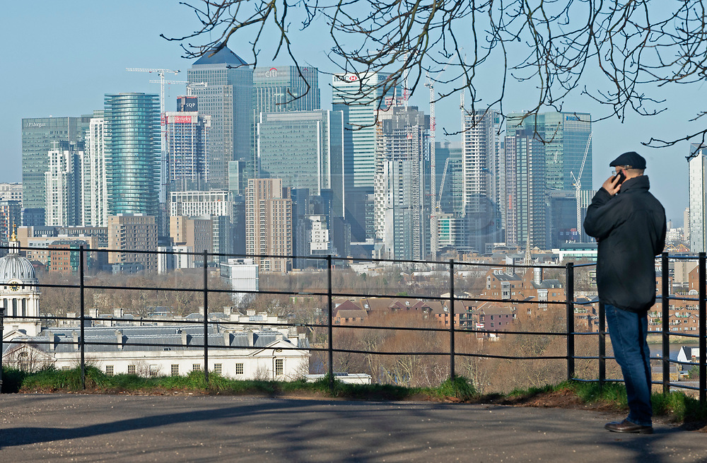 © Licensed to London News Pictures. 08/01/2019. Greenwich, UK. Blue sky over Canary Wharf, Winter sunny weather at Greenwich Park,Greenwich today but temperatures at set to plunge. Photo credit: Grant Falvey/LNP