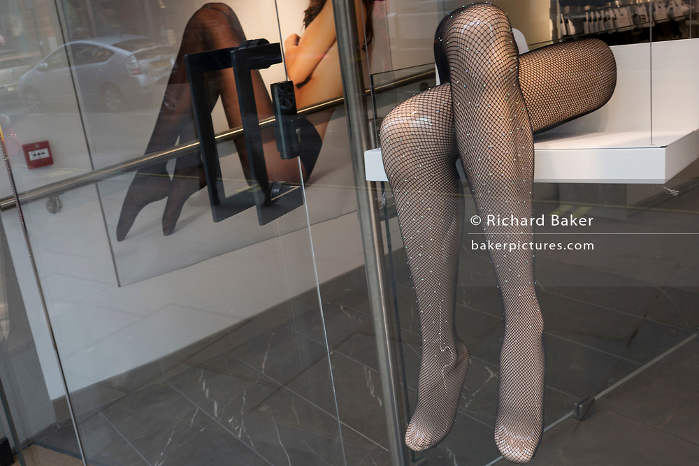 The legs and stylish tights on a shop mannequin in a womens' retailer on Long Acre near Covent Garden, on 5th March 2018, in London, England.