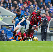 7th April 2018, Ibrox Stadium, Glasgow, Scotland; Scottish Premier League football, Rangers versus Dundee; Roarie Deacon of Dundee goes past Graham Dorrans of Rangers