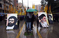 Supporters carry images of Sayid Hasan Nasrallah and Ayatollah Rudhollah Khomeni as Hezbollah members pay their respects to slain militant commander Imad Mugniyeh in Beirut, Lebanon on Feb. 14, 2008. Imad Mugniyeh was killed in a mysterious car bombing in Damascus, Syria. Mugniyeh a.k.a. Hajj Radwan, was among the most feared terror operatives in the world.