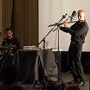 November 20, 2012 - New York, NY : Mexican flutist and composer Alejandro Escuer, right, and composer and sound artist Felipe Perez Santiago, left, perform 'Flying,' a multi-disciplinary concert at the Americas Society on the Upper East Side in Manhattan on Tuesday night. CREDIT: Karsten Moran for The New York Times
