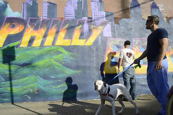"""In south Philadelphia, PA., U.S. Artists Old Broads and Disto are seen on March 9, 2016  as they work to complete a mural in support of candidate for the Democratic nomination Bernie Senders. The work titled """"Philly the Bern"""" is located on the corner of 22nd St. and Catharine St, in the South Philadelphia neighborhood of Philadelphia, PA., USA."""