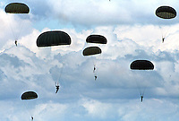 Paratroopers land as part of Colombian Special Forces training in Tolemaida, a Colombian military base about 60 miles outside of Bogotá. (Photo/Scott Dalton)