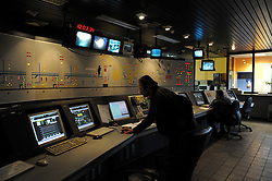 Arcelor-Mittal employees, work in the control room for blast furnace B, at the Ougree facility near Liege, Belgium, Monday, Feb. 9, 2009. (Photo © Jock Fistick)