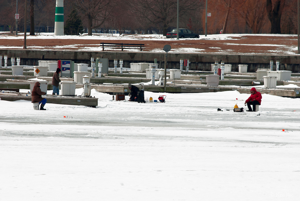 Ice fisher in red jacket, Chicago, Montrose Harbor