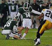 Oct 24, 2009; East Lansing, MI, USA; Michigan State wide receiver Jordan Benton (18) holds for kicker Brett Swenson (14) during the first quarter against Iowa Hawkeyes at Spartan Stadium.  Mandatory Credit: Jason Miller-US PRESSWIRE