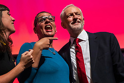 © Licensed to London News Pictures. 26/09/2018. Liverpool, UK. Labour Leader Jeremy Corbyn MP (R) with a member of the Liverpool People's Choir after finishing his speech at the end of the Labour Party Conference. Photo credit: Rob Pinney/LNP