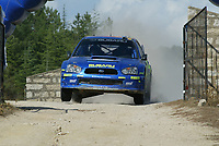 Norway's driver Petter Solberg and British co-driver Phillip Mills go airborne in  their Subaru Impreza in the Tantariles Special Stage on the first day of the Rally of Sardinia, Italy, October 1, 2004.