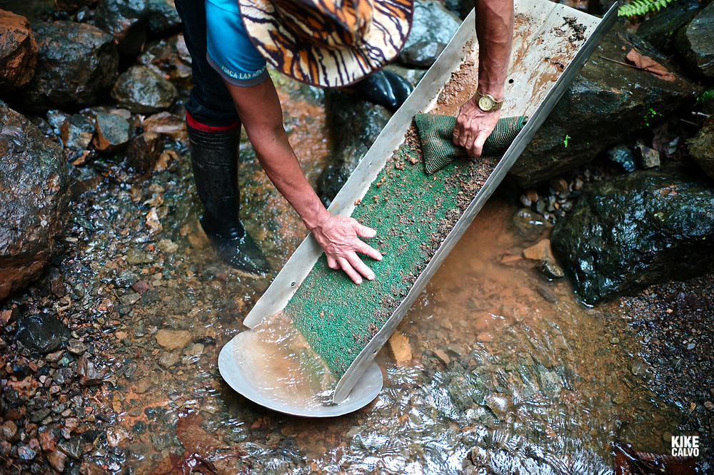 Artisanal miner, a small-scale gold mining without mercury  Artisanal miner, a small-scale mining without mercury, in search of gold in a small river creek