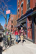 A couple walks on Berry Avenue in the Williamsburg neighborhood in Brooklyn, New York during Springtime.