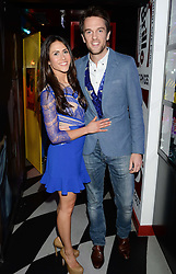 DUNCAN STIRLING and his wife ZOE at a party to celebrate the launch of Charlie Gilkes and Duncan Stirling's new nightclub 'Disco' at 13 Kingly Court, London on 26th June 2013.