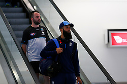 England's Moeen Ali as the team arrive at Adelaide Airport.