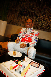 STUTTGART, GERMANY - Monday, January 7, 2008: Lewis Hamilton cuts a cake at launch of the Vodafone McLaren Mercedes MP4-23 Formula One car for the 2008 season at the Mecedez-Benz museum in Stuttgart. (Photo by Michael Kunkel/Hochzwei/Propaganda)