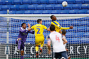 Wimbledon players defend a cross during the EFL Sky Bet League 1 match between Bolton Wanderers and AFC Wimbledon at the University of  Bolton Stadium, Bolton, England on 7 December 2019.