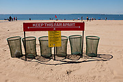 "Brooklyn, NY - 14 June 2020. A sign reading ""keep thsi far apart"" and indicating 6 feet of social distance on the beach at Coney Island reminds people to keep well apart from each other. At this time the beach is still closed to swimming."