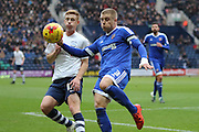 Preston North End Striker Eoin Doyle and Brentford Defender Jake Bidwell battle during the Sky Bet Championship match between Preston North End and Brentford at Deepdale, Preston, England on 23 January 2016. Photo by Pete Burns.