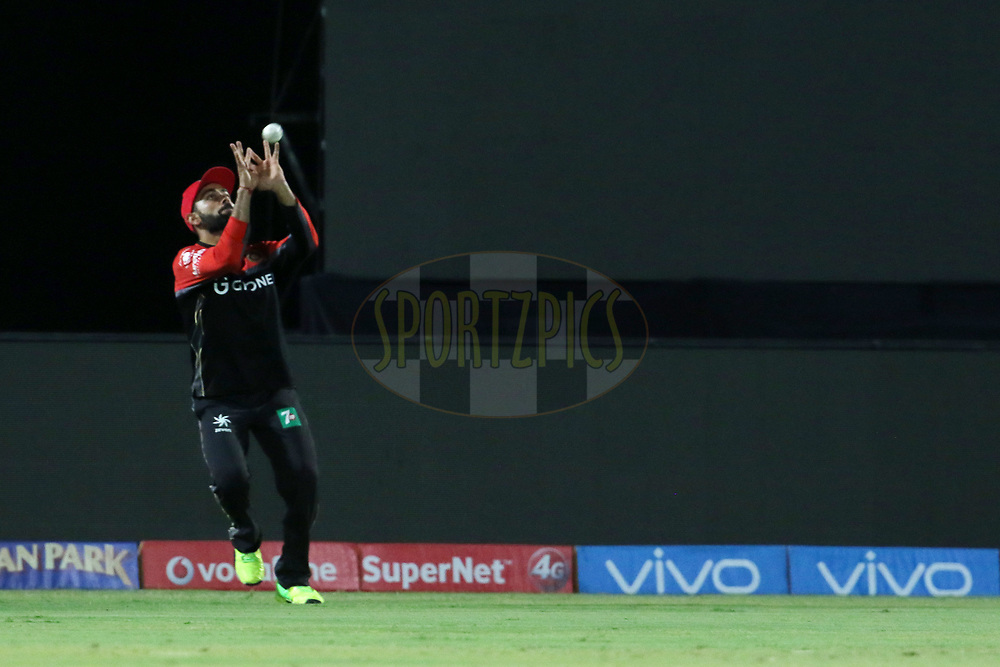 Royal Challengers Bangalore captain Virat Kohli takes a catch of Dinesh Karthik of the Gujarat Lions during match 20 of the Vivo 2017 Indian Premier League between the Gujarat Lions and the Royal Challengers Bangalore  held at the Saurashtra Cricket Association Stadium in Rajkot, India on the 18th April 2017<br /> <br /> Photo by Vipin Pawar - Sportzpics - IPL