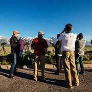 Teten Science Schools tour participants watch a herd of elk forage in the early morning hours. Tetons in the background. (Greg Peck, Matthew Bart, Sean Baker, Maura Bushior, Katie-Cloe Stock, Tracy Logan, Paul Maddex, Lead Guide Dawson)