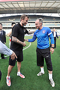 NANJING, CHINA - JUNE 18: (CHINA OUT) <br /> <br /> David Beckham Visits Jiangsu Sainty Football Club<br /> <br /> David Beckham shakes hands with Jiangsu Sainty head coach Dragan Okuka (R) during his meeting with Jiangsu Sainty players at Nanjing Olympic Sports Centre on June 18, 2013 in Nanjing, Jiangsu Province of China.<br /> ©Exclusivepix