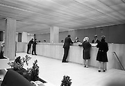 17/08/1967<br /> 08/17/1967<br /> 17 August 1967<br /> Interiors of the First National City Bank, St. Stephen's Green, Dublin. View of customers at bank counter. Note lack of protective screen at the counter.