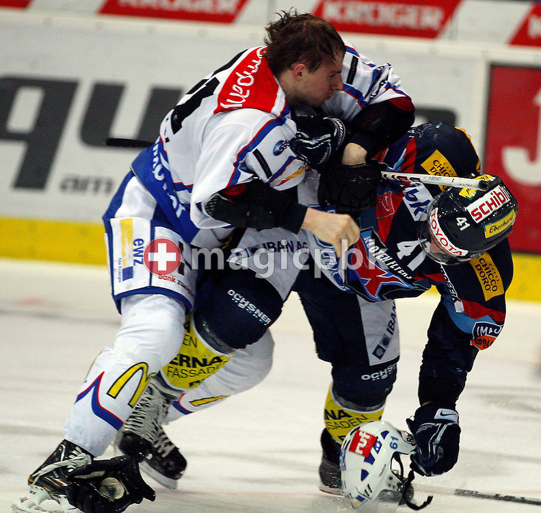ZSC Lions forward Alexey Krutov (L) and Kloten Flyers forward Michael Liniger fight in a scuffle during ice hockey game three of the Swiss National League A Playoff Quarterfinal between Kloten Flyers and ZSC Lions held at the Kolping Arena in Kloten, Switzerland, Thursday, March 3, 2011. (Photo by Patrick B. Kraemer / MAGICPBK)