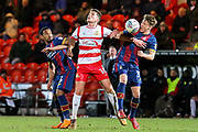 Bradford City forward Joel Grodowski and Doncaster Rovers midfielder Jordan Houghton challenge for the ball in the air during the EFL Sky Bet League 1 match between Doncaster Rovers and Bradford City at the Keepmoat Stadium, Doncaster, England on 19 March 2018. Picture by Aaron  Lupton.