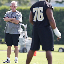 May 24, 2012; Metairie, LA, USA; New Orleans Saints associate head coach Joe Vitt and rookie defensive tackle Akiem Hicks (76) during organized team activities at the team's practice facility. Mandatory Credit: Derick E. Hingle-US PRESSWIRE