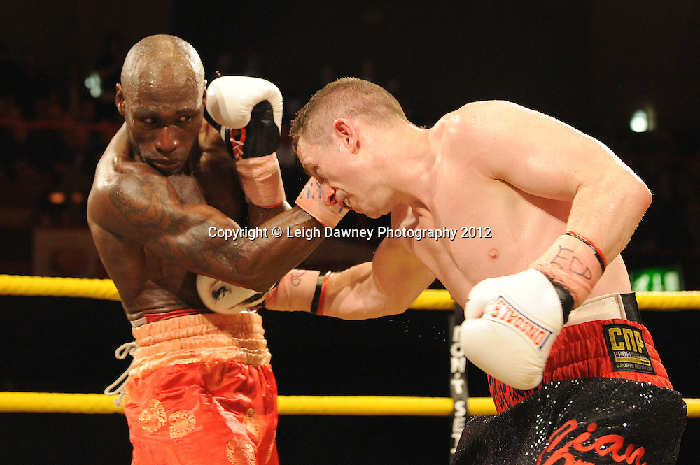 DeMarcus Corley (red shorts)  defeats Paul McCloskey after the referee Ian John-Lewis stops the fight in the tenth round to claim the  Light Welterweight contest at Kings Hall, Belfast, Northern Ireland on Saturday 5th May 2012. Promoted by Prizefighter/Matchroom Sport. © Leigh Dawney Photography 2012.