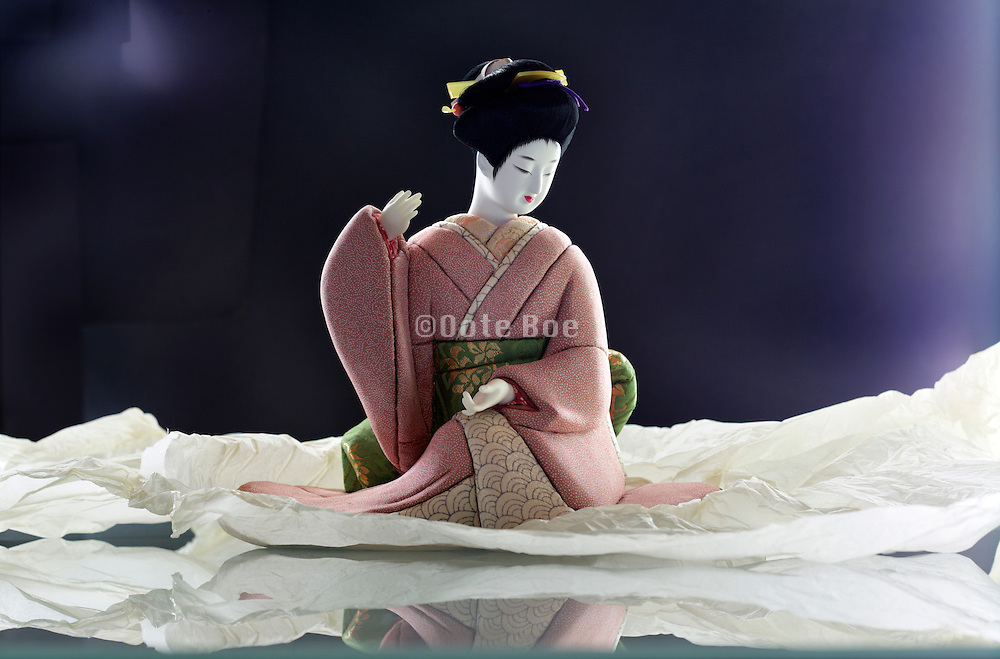 Japanese geisha doll with protective paper wrapping